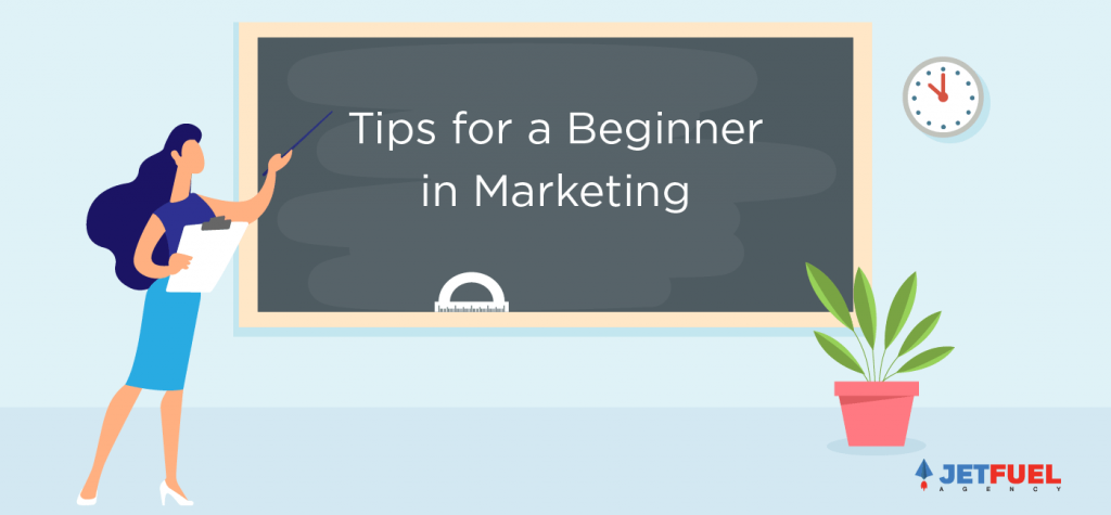 "A teacher pointing at a black board with ""tips for a beginner in marketing"" written."