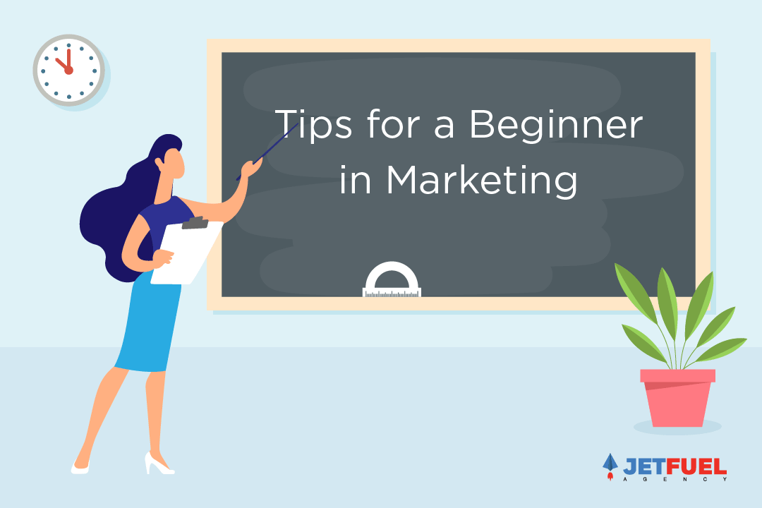 "A teacher pointing to ""Tips for a beginner in marketing"" on a blackboard."
